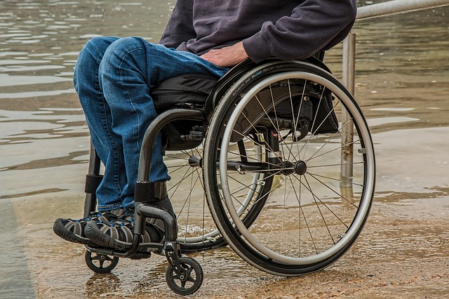 Man in wheelchair by the water