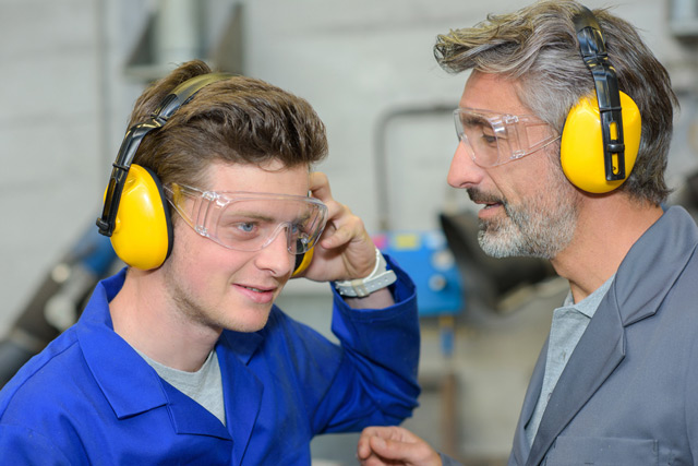 two men with ear protectors