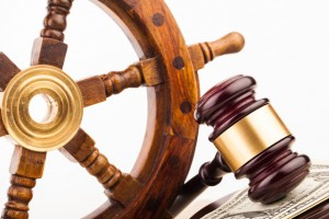 Maritime injury claims, gavel and ship wheel