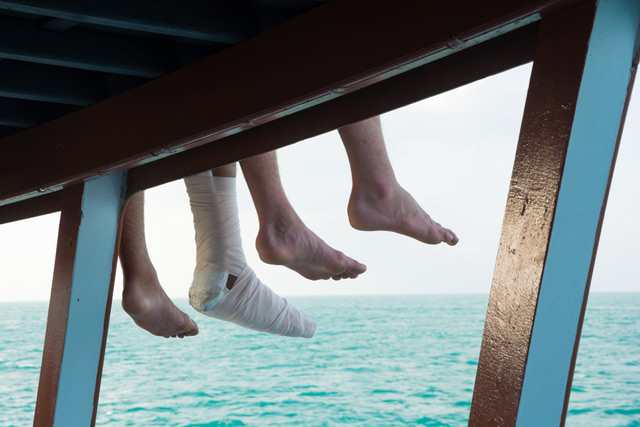 injured foot dangling off boat