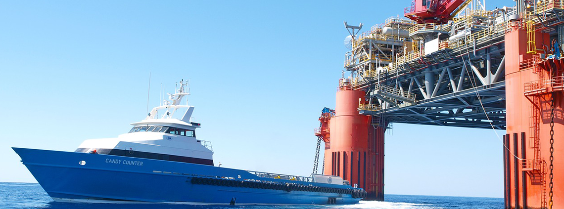 oil rig and blue vessel